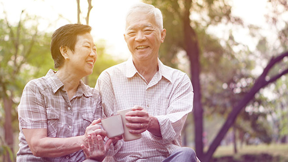 Asian senior couple enjoying cup of tea
