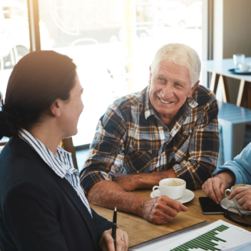 senior couple in cafe talking through options with provider