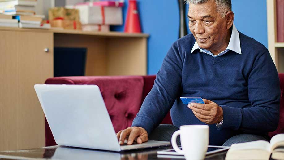 Indian man browsing on his laptop